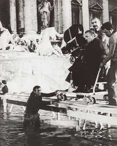Federico Fellini ready to direct one of the most famous scenes of cinema history - La Dolce Vita, 1960 -