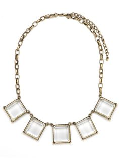 This cool necklace works the simple, sleek side of winter glamour. It features a series of crystal-clear gemstones—all cleanly cut in graphic baguette style.