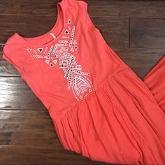 """NWOT Free People Embroidered Cotton Maxi Dress Beautiful Free People cotton maxi dress with geometric embroidered front and back details and a cut out back.  Slub-knit cotton bodice renders a casual-chic midi dress featuring a cap-sleeve bodice and a sweeping high/low skirt finished and a raw hemline. Partially lined. Perfect New condition, bought but Haven't worn.    Measurements: 48"""" front length 52 1/2"""" back length Free People Dresses High Low"""