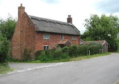 brick cottage   TG4206 : Red brick cottage with thatched roof