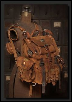 Kustom to da max! Saddleback Leather Co. Front Pocket backpack with tons of vintage Swiss Army bits, patina, brass, copper and the most. Steampunk Accessories, Leather Accessories, Kleidung Design, Leather Projects, Character Outfits, Character Design Inspiration, Steampunk Fashion, Leather Backpack, Leather Bags