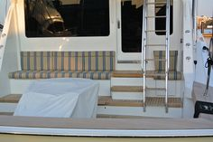Sweetums, a Hatteras Yachts convertible sportfisher with custom mezzanine cushions made fabricated with Brentano indoor/outdoor fabric, Crystal Coast Interiors