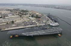 The Navy's newest and most technologically advanced aircraft carrier USS Ronald Reagan (CVN 76), enters San Diego harbor