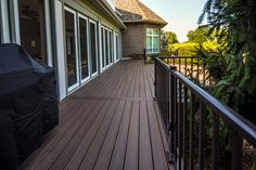 Brad Van Weelden Co. installed mocha-colored TimberTech Earthwood Evolutions® Legacy composite decking, one of three new colors available this year, extending the owner's indoor style and personality to an outdoor living experience with timeless style and a 25-year fade and stain warranty.