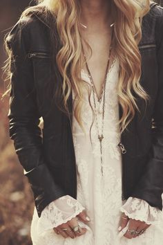 Love this sweet romantic blouse with the tough leather moto jacket combo.