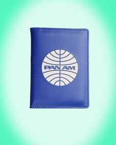 Vintage Style Pan Am Logo Passport Cover in Blue - Pan Am Brand bags and accessories for the jet set!  These new versions of classic Pan Am travel bag designs are made with unbelievable quality and attention to detail.  A Pinup Girl Favorite Find!  This classic passport cover is made of a high quality leather-like PU and embossed with the classic Pan Am globe logo.  Inside is lined with the signature airport print.  Clear slip pocket window allows for easy access to ID Info while holding…