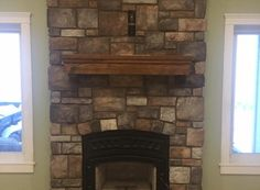 Beautiful fireplace with our Southern Hackett (Color: Quarry) manufactured stone veneer from Kodiak Mountain Stone Great for both interior and exterior application designs. Click through the link to see more great ideas for your home. Manufactured Stone Veneer, Bathtub Surround, Interior And Exterior, Interior Design, Fireplaces, Natural Stones, Galleries, Diy And Crafts, Southern