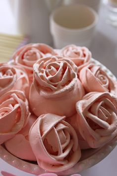 Meringues(?) piped as roses and tinted pink
