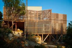 french architecture firm bonte and migozzi completes its contemporary wooden cabin, KGET, overlooking the azure mediterranean sea in greece. Architecture Durable, French Architecture, Architecture Design, Villa, Everything Is Illuminated, Timber Cabin, Wooden Cabins, Wooden Houses, Timber Cladding
