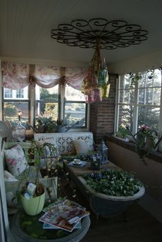 Spring Porch, love colored bottles, really like to tub planter and the colored bottles