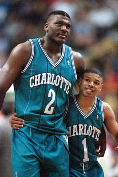 c8d8ca017bf Larry Johnson (left) hugs Charlotte Hornets teammate Muggsy Bogues during  the final seconds of an overtime win in