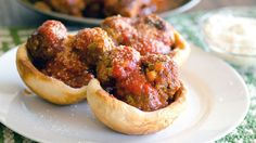 These mozzarella-stuffed meatballs are slowly cooked in pizza sauce, and then served in biscuit bowls for a fun family meal.