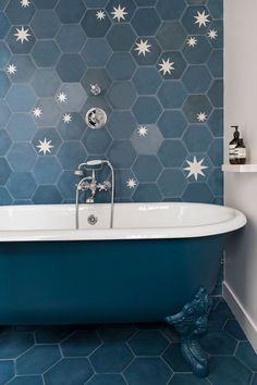 starburst cement tiles in navy blue bathroom with hexagon floor tiles
