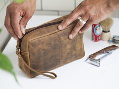 View our  Leather Wash Bag from the   collection #fathersdaygifts #fathersday #fathersdaygiftideas #leatheraccessories #vintageaccessories #uniquegifts #giftsfordad Leather Gifts, Leather Wallet, Leather Accessories, Vintage Accessories, Unique Gifts For Men, Wash Bags, Toiletry Bag, Gifts For Father, Laptop Bag