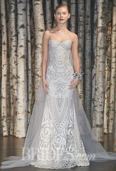"Brides.com: . ""Beverly Hills"" strapless threadwork embroidered sheath wedding dress with a sweetheart neckline and detachable tulle train, Naeem Khan"