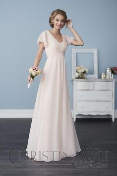 Made from chiffon and in the iconic style you love, this gown has a pleated waist and bust, with delicate butterfly sleeves.