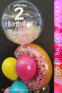 Donut theme party balloons decorations for birthday with clear personalized bubble balloon with tulle inside in pastel donut colors with big Myla donut shape balloon and bright donut colors latex balloons centerpiece #donutballoon #tulleballoons #brightcolorballoons #donutcolorsballoon #bubbleballoons #donutthemeparty #girlbirthdayballoons #2ndbirthdayballoon #secondbirthday #latexballoons #personalizedballoons #nameballoons #messageballoons #colorfulballoons #balloondecorations #balloondelivery Big Round Balloons, Light Up Balloons, Clear Balloons, Name Balloons, Tulle Balloons, Printed Balloons, Girl 2nd Birthday, 2nd Birthday Parties, Birthday Ideas