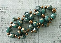 Linda's Crafty Inspirations: Playing with my beads...Bicones - Hematite Luster Aquamarine