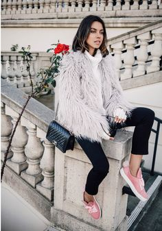 The elements of an incredible spring outfit are: a textured jacket, casual sneakers, skinny jeans, and a pair of Rodenstock sunglasses.