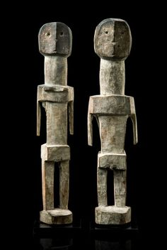 Togo or Ghana, Ada wood, mat patina, kaolin, black paint, a female and a male figure, of abstract form, showing simplified facial features, min. dam., fissures, slight signs of abrasion, on metal base. H: 38 cm resp. 38,5 cm H: 15 inch resp. 15.2 inch