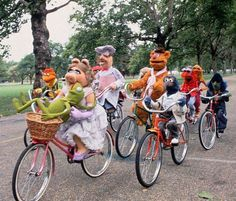 The Muppets ride bikes.