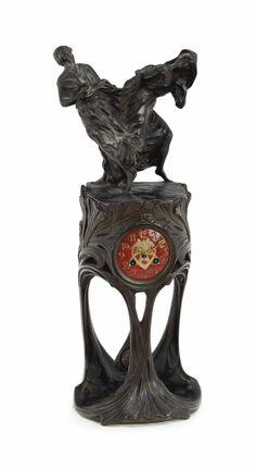 A PATINATED BRONZE AND ENAMEL FIGURAL MANTEL CLOCK, CIRCA 1900
