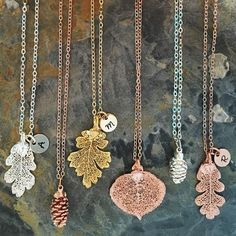 This necklace is comprised of a real lacey oak leaf, aspen leaf, or pinecone that has been dipped in 14k...