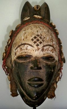 Gabon  153. A superb and not often seen two-toned Punu helmet mask  Height 31cm