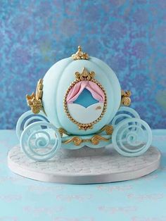 Beautiful blue Cinderella cake by Zoe Clark. Maybe use the base design from the Debbie Brown book and use moulds (or pipe) to add the rococo details.