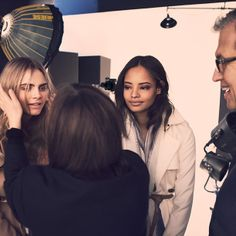 British models Cara Delevingne and Malaika Firth captured in between takes of the new Burberry Autumn/Winter 2014 campaign with Mario Testino
