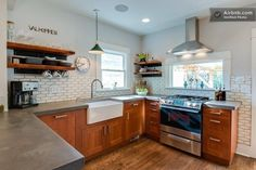 poured sink and counter   farmhouse sink and poured concrete countertops give a rustic feel to ...