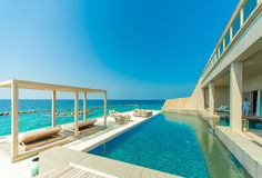 Architectural Photography of Gray Granite Swimming Pool and Outdoor Lounge at Beach Side · Free Stock Photo Best European City Breaks, Somerset Hotel, Bali, Maldives Holidays, Madrid, Gunite Pool, Destinations, Villa, Need A Vacation