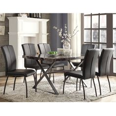 Feel a new vibe with this retro modern style dining set. The faux marble table top with the basic X frame base compliments the classic black PU chairs perfectly. This spacious addition would make a fantastic focal piece for your next dinner party.