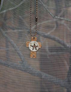 (http://www.dangchicks.com/product/new-arrivals/cross-star-necklace/)