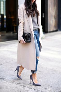Kat Tanita of With Love From Kat wears a Sandro long wool camel coat with grey suede pumps, and Rag & Bone boyfriend jeans in Meatpacking District, NYC.