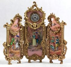 "VIENNESE ENAMEL 3 PANEL SCREEN CLOCK, PINK GROUND, MEASURES 5 7/8"" X 4 3/4"""