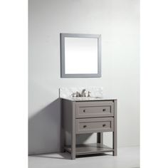 Solid oak cabinetry featuring soft-closing drawers and on open shelf at the bottom is finished in light gray. This transitional style vanity includes a marble countertop with matching backsplash and a matching framed mirror.