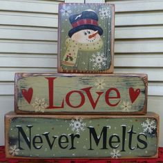 Christmas Love Never Melts Green Red Block Stackers Shelf Sitters Wood Primitive Antiqued. $18.95, via Etsy.
