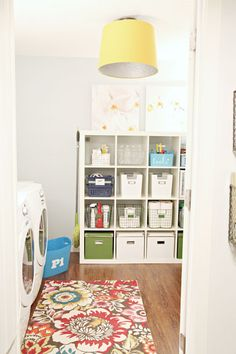 Super Cute Small Laundry Room Ideas-- Changing out light fixtures, adding rugs, and painting floors.