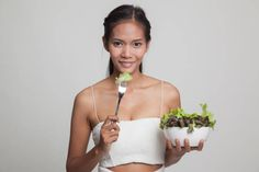 healthy asian woman with salad