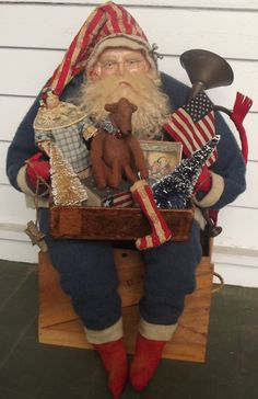 Handmade Patriotic Santa Claus By Kim Sweet~Kim's Klaus~Vintage blue wool~antique quilt hat~vintage wood box filled with handmade Teddy Bear~Handmade Doll~Bottle Brush Trees~Handmade Book~American Flag~Painted Wood Block~Vintage French Horn looped around his arm~Ebay Seller~Kim-s-klaus-s