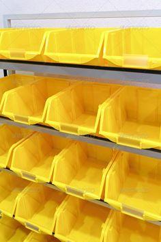 Yellow plastic racks ...  bin, bins, box, compartment, inventory, logistic, louvre racks, open, parts, plastic, rack, racking, racks, row, set, shelf, shelves, sort, sorting, storage, storage bins, storehouse, storing, tub, warehouse, workshop, yellow