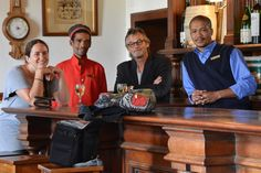 A new member joins the Site_Specific team in Matjiesfontein - Mirella Bandini at the Lord Milner Hotel pub with PC van Rensburg, Alnick the barman and a hotel staff member in his period uniform. PC takes it upon himself to initiate new team members into the project, especially if there's rain and nothing else to do but visit the pub. After four trips to Matjiesfontein, PC and Alnick are well acquainted, renaming that corner of the pub the Snake Eagle Thinking Path corner. katty vandenberghe Hotel Staff, Team Member, Period, Snake, Trips, Eagle, Lord, Rain, Corner