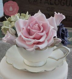 Sugar flowers in a gumpaste teacup - Cake by Paulacakecouture