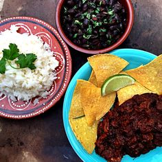 Slow-cooked pork in tequila and ancho chili, served with homemade tortilla chips, white rice and black beans