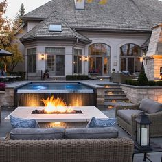 Combo in 15 Traditional Pools with Fire Pits A small pool with fountain looks great lit up by the fire pit in front. So pretty!A small pool with fountain looks great lit up by the fire pit in front. So pretty!