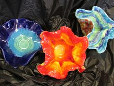 """Chihuly style ceramic bowls by my 4th grade students; approx. 8"""" to 10"""" across; art lesson by Susan Joe"""