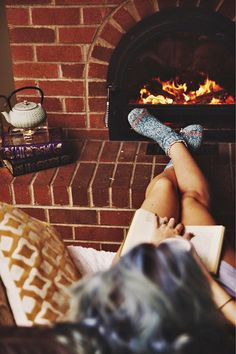 Reading nearby fireplace is so relaxing