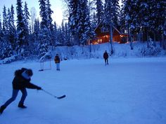 Pond hockey rink in front of cabin