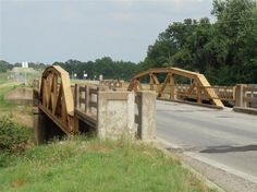 The original Route 66 bridge over Pryor Creek, built in 1926; by 1932, it had been replaced with a new bridge (right) on a straighter, wider alignment that still carries westbound Route 66 traffic.